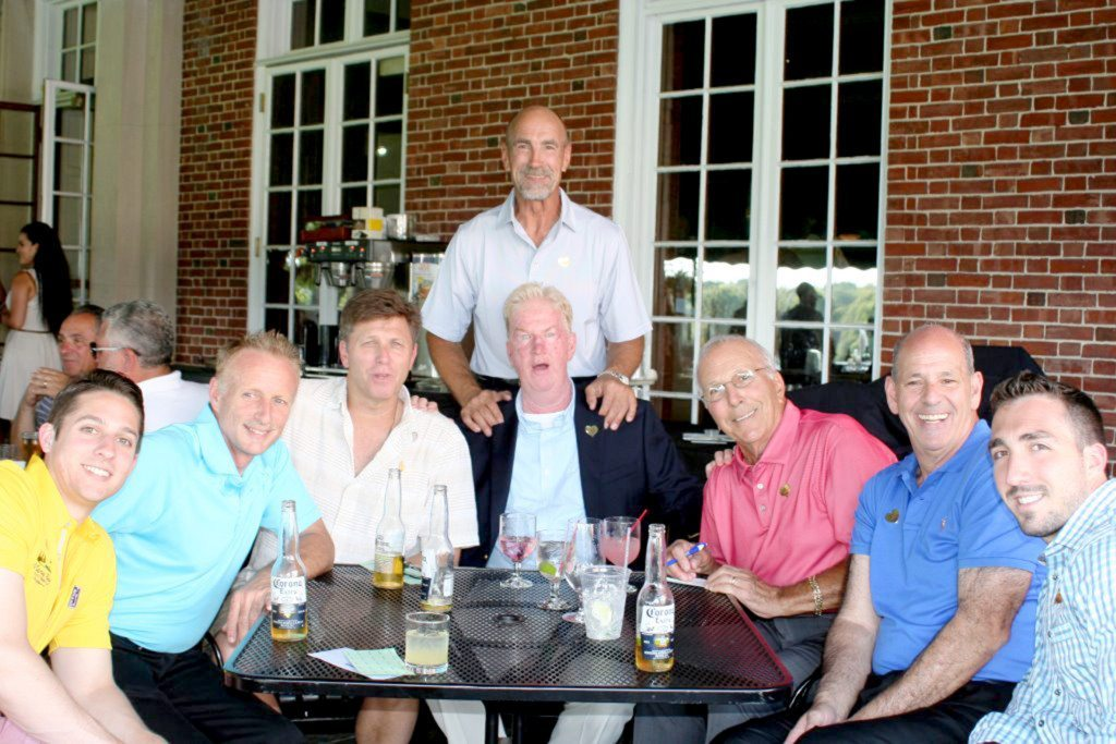 Former NY Islander Bobby Nystrom (standing) enjoyed a great day of golf. Pictured from left to right: Chris Shapiro, Larry Shapiro, Gary Burke, Kevin Mahoney, Dominic DiConstanzo, Steve Schwarz, and Cory Casamassina.