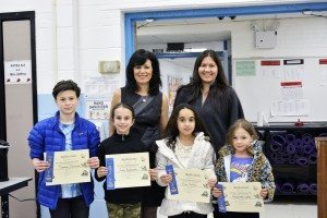 Students, Principal Joanne Mannion and PTA committee chairperson Jeanine Berliner at the March PTA meeting's special ceremony for Reflections participants.