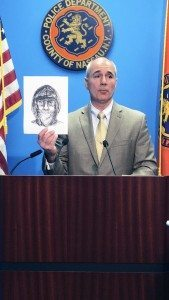 Nassau County Police Department Detective Lt. Richard LeBrun holds up a police sketch of the suspect.