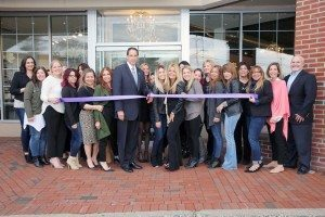 Mondays at Racine and Erika Cole employees prepare to cut the ribbon with Oyster Bay Town Clerk James Altadonna Jr.