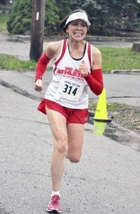 Pamela Lee of Syosset was a study in determination as she headed for the finish line.
