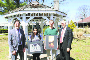 Photography students Sanaya Dhablania and Evan Garry are congratulated by Principal Dr. Giovanni Durante (left) and district coordinator of fine and performing arts Michael Salzman.