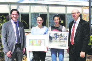 Students Kristen Clark (second from left) and Lauren Gruber are congratulated here by Principal Dr. Giovanni Durante (far left) and district coordinator of fine and performing arts Michael Salzman.