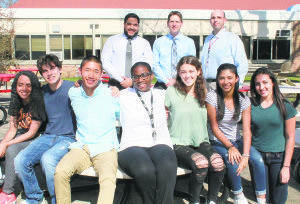 Breaking Borders participants from Syosset and Freeport high schools recently met to discuss topical issues in the Syosset High School courtyard: Seated (from left) are Orianna Soriano, Jake Gould, Zachary Chan, Victoria Wright, Peri Lund, Ismary Jimenez and Carly Battipaglia. Standing (from left) are teachers/advisers Jose Ortiz, David Steinberg and Josh Levitt.