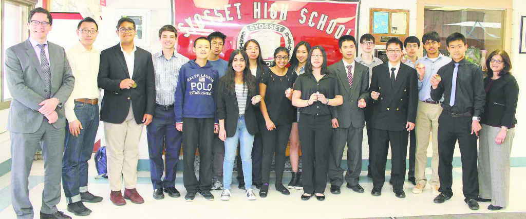 Winners of the LI Math Fair high school competition from Syosset and their adviser John Chae (second from left) are congratulated by Syosset Principal Dr. Giovanni Durante (far left) and district Math Coordinator Angela Kozlowski (far right).