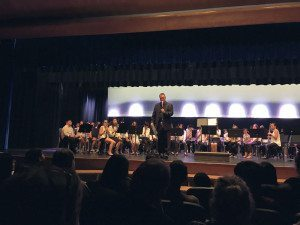 Music director Wayne Schuster addresses the audience.