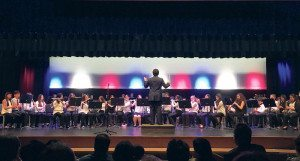 Student conductor Matthew Lecher leads his eighth-grade band mates.